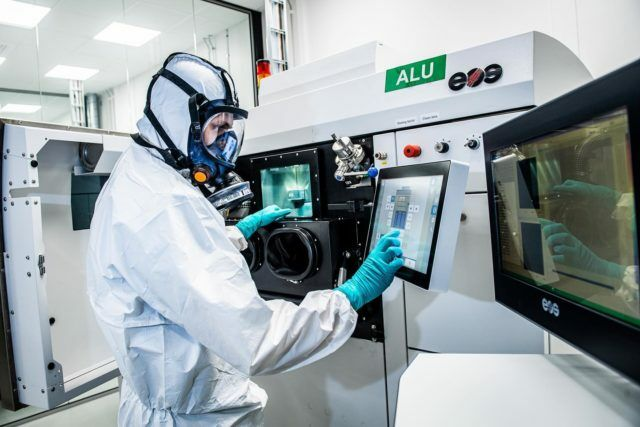 Additive manufacturing employee in working environment